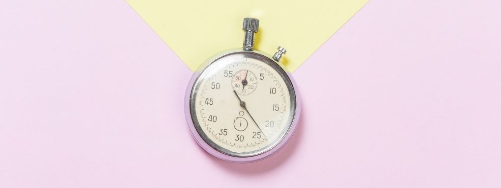 Old fashioned mechanical stopwatch on pastel background