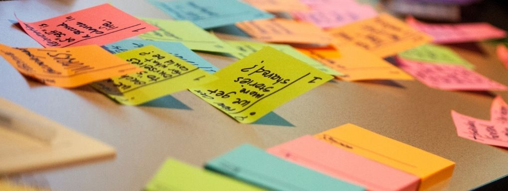 colourful post it notes on a desk