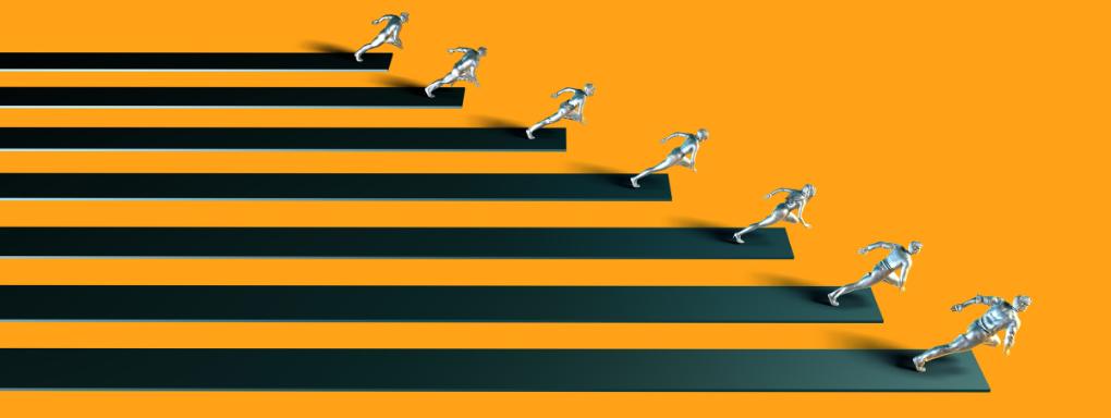 Silver statues racing to the finish line with black stripes behind them
