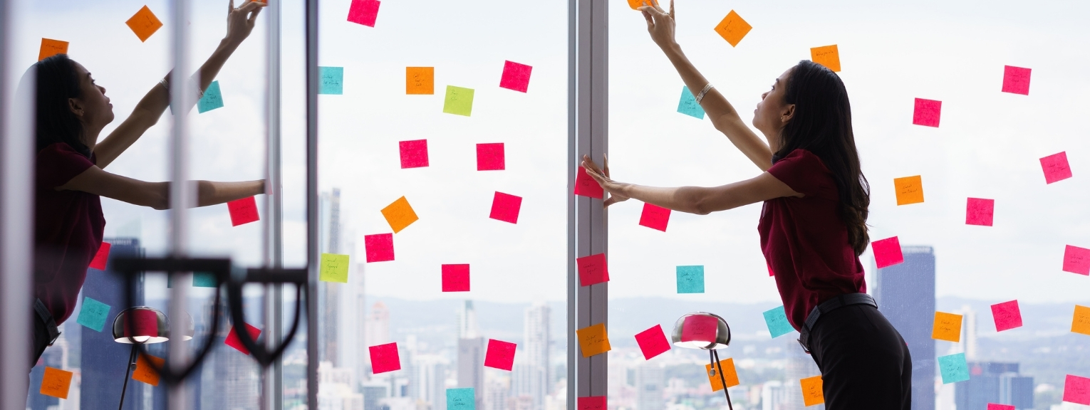 Post it notes all over a window