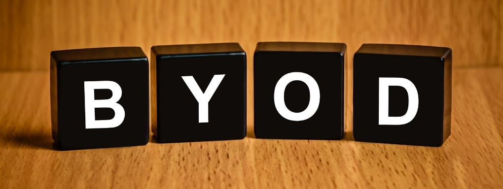 "Black cubes with white letters spelling out ""BYOD"""